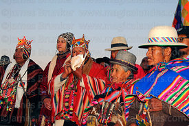 Aymara shamans or amautas wait for sunrise during Aymara New Year celebrations, Tiwanaku, Bolivia