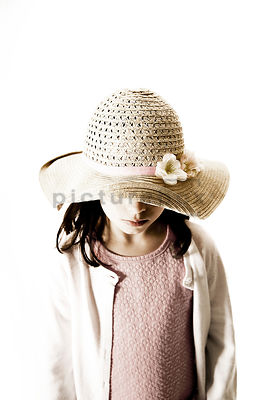 An image of a little girl, with a hat on.