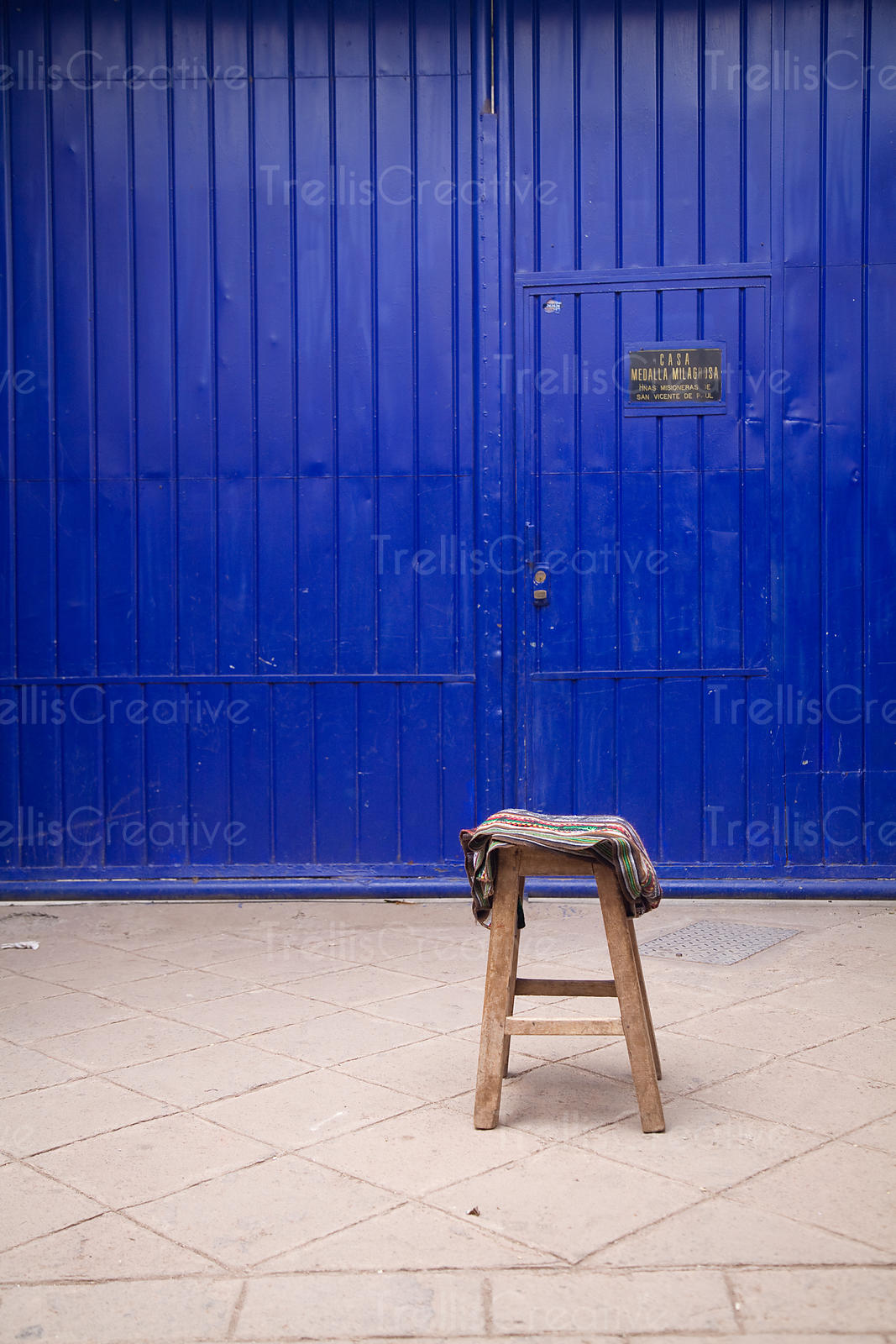Wooden stool and blue door, Calca, Peru