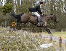 William Bell jumping a hedge at Orton Park