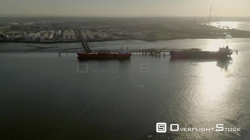 Drone descends through spring dawn to Grays Oil Storage Depot in Essex England. Oil Tanker Sten Fjell is in port