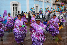 Cholitas dancing the morenada at Virgen de la Candelaria festival, Puno, Peru