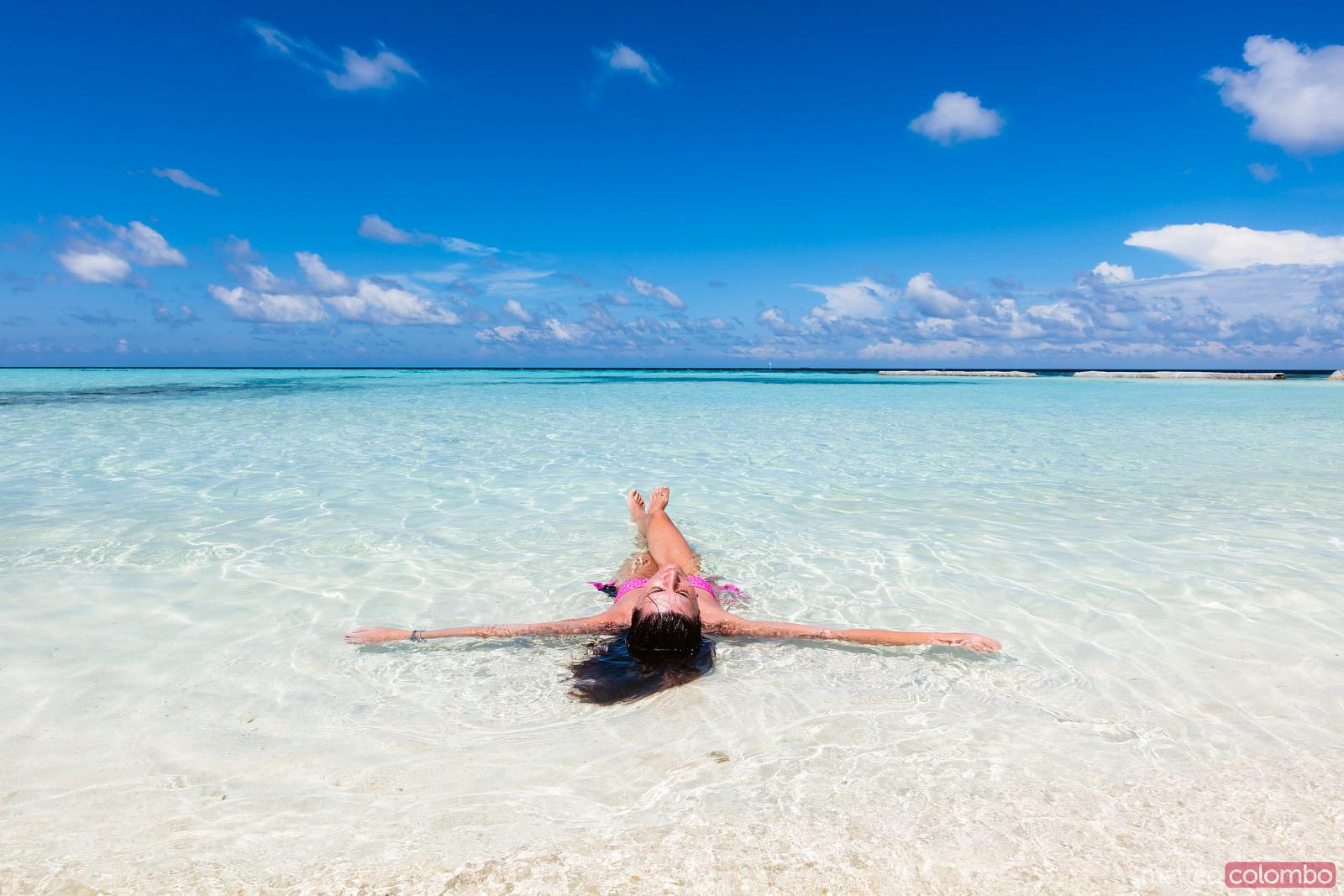 Woman lying down on the beach, Maldives