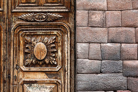 Old wooden colonial door and Inca wall, Cusco, Peru