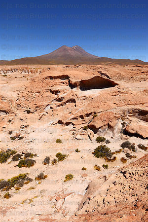 Eroded lava rock formations and Cerro Tomasamil volcano, North Lipez region, Bolivia