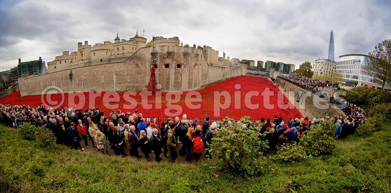 Panoramic shot of Visitors queuing to see The Blood Swept Lands and Seas of Red installation at The Tower of London