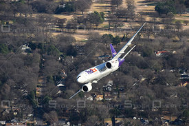 Fed Ex Boeing 777 Flying over Memphis Tennessee, air-to-air aerial photo