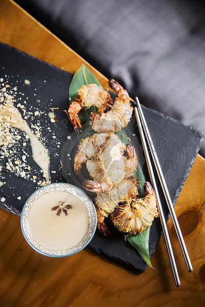Asian dish - grilled prawns in hairy dough