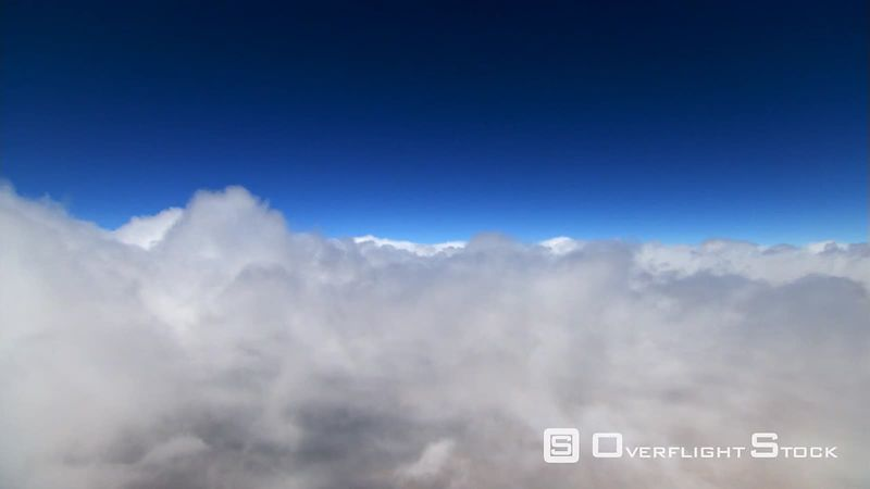 Flying over white clouds in blue sky