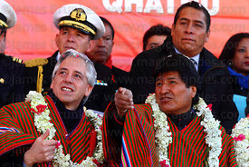 Bolivian president Evo Morales (right) gestures towards the cable car cabins with vice president Alvaro Garcia Linera (left) during the Red Line inauguration ceremony , La Paz, Bolivia