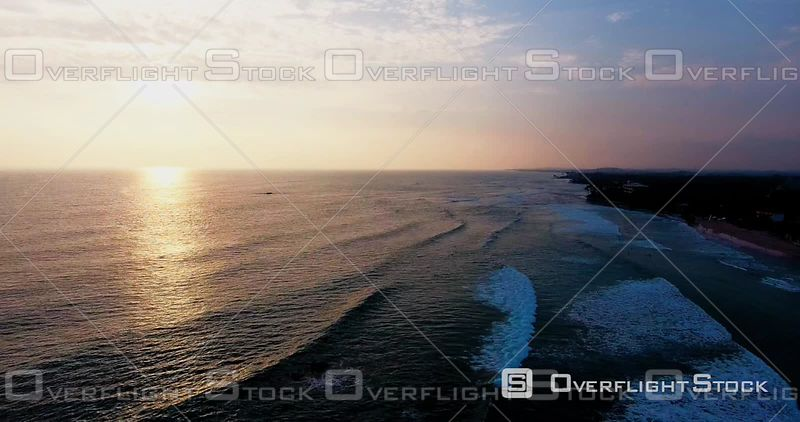 Traditional Fishermen Standing on Pole for Fishing at Sunset, Near Galle, Sri Lanka, Filmed by Drone