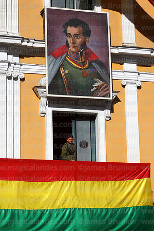 Soldier in window of presidential palace and portrait of Antonio José de Sucre during Independence Day, La Paz, Bolivia