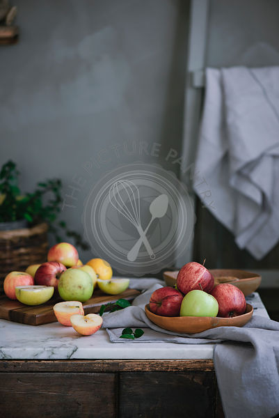 Various red and green apples in a fruit bowl
