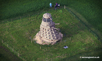 aerial photographs of giant Dalek made from straw. This 35 ft tall Dalick was created by Snugburys the ice cream people at Park Farm Nantwich Cheshire.