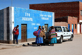 Local people in front of house painted with MAS party political propaganda, Curahuara de Carangas, Oruro Department, Bolivia