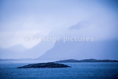 Misty view across the sea to Storøya, Norway
