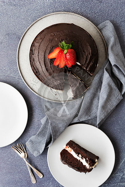 Gluten-free chocolate dessert cake with a slice of cake on a plate.