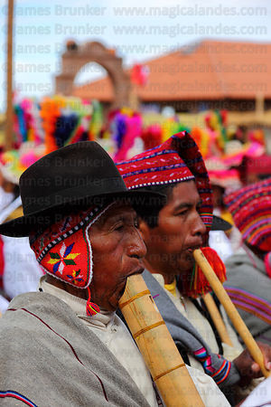Musicians playing wooden flutes or pinkillus at San Santiago festival , Taquile Island , Peru