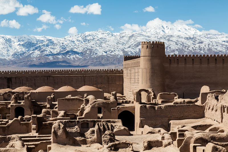 Elevated View of Ruins of Rayen with Snow-capped Mountains in the Background