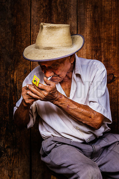 Portrait of an Elderly Man Lighting a Cigarette at the Antigua Market