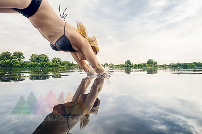 Woman jumping into water