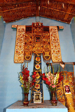 Embroidered robes and cross inside church at Las Salineras, Maras, near Cusco, Peru