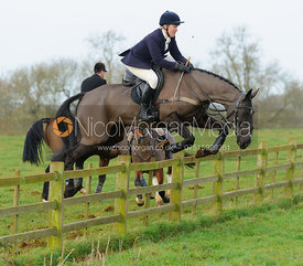 Emilie Chandler jumping a post and rail fence at Goadby Hall