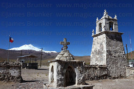 Guallatiri village square, church and bell tower , Guallatiri volcano in background , Las Vicuñas National Reserve , Region XV , Chile