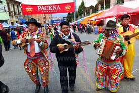 Musicians playing charangos, accordion and guitar during parades for the Entierro del Pepino, La Paz, Bolivia