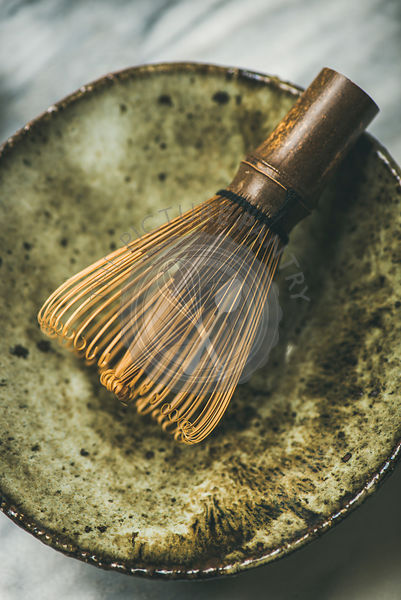 Chasen bamboo whisk, Chawan bowl over grey background