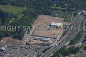 Stockport aerial photograph of the development of old industrial land Bailey Road Portwood and the M60 motorway junction 27 Portwood roundabout