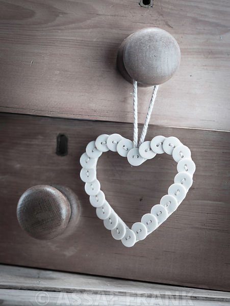 heart made of buttons hunging on a handle