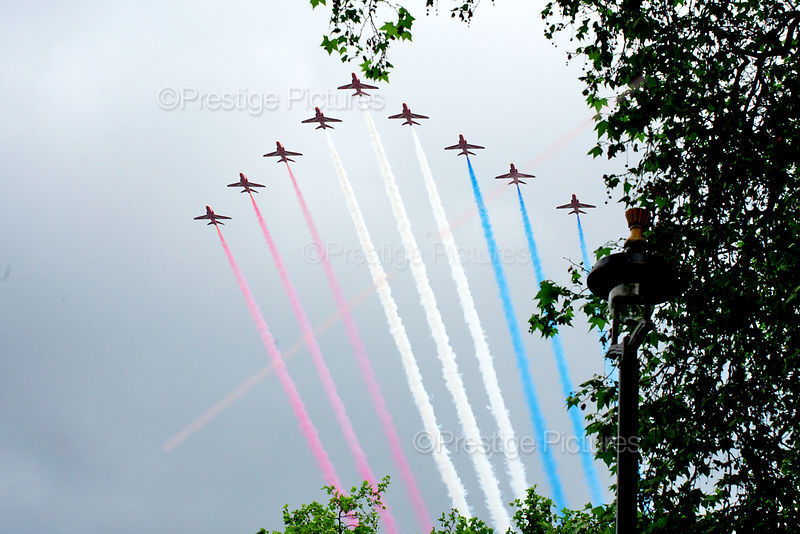 Nine Red Arrow Jets Fly Past Buckingham Palace