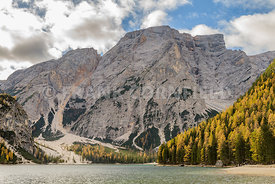 Stunning Lago di Braies a beautiful Alpine lake in wonderful autumn colour.  The Braies lake is in Dolomites, South Tyrol, Italy.