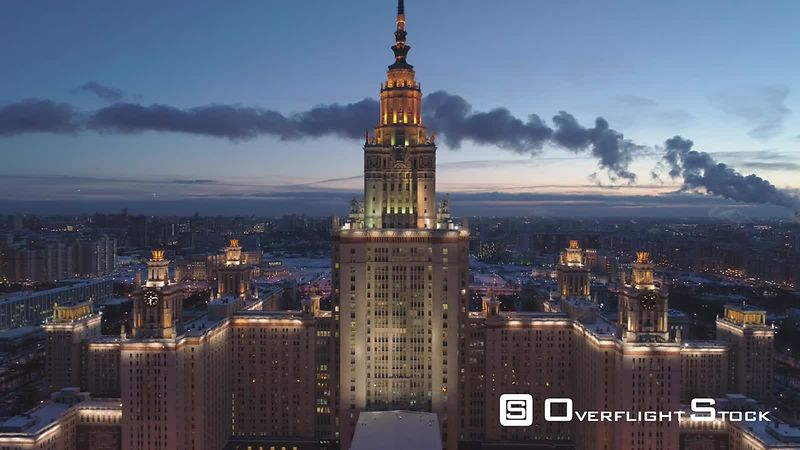 Moscow State University Main Campus and Illuminated Moscow Skyline at Clear Winter Night. Russia. Aerial View. Drone is Flying Forward and Approaching to Spire. Establishing Shot.