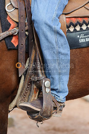 Stock photo of cowboy boots in western stirrups