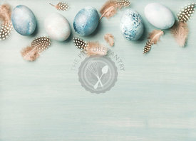 Painted traditional eggs for Easter holiday over light blue background