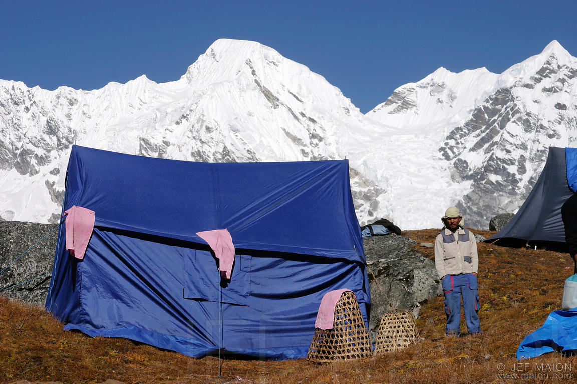 Sherpa guide and tents at basecamp