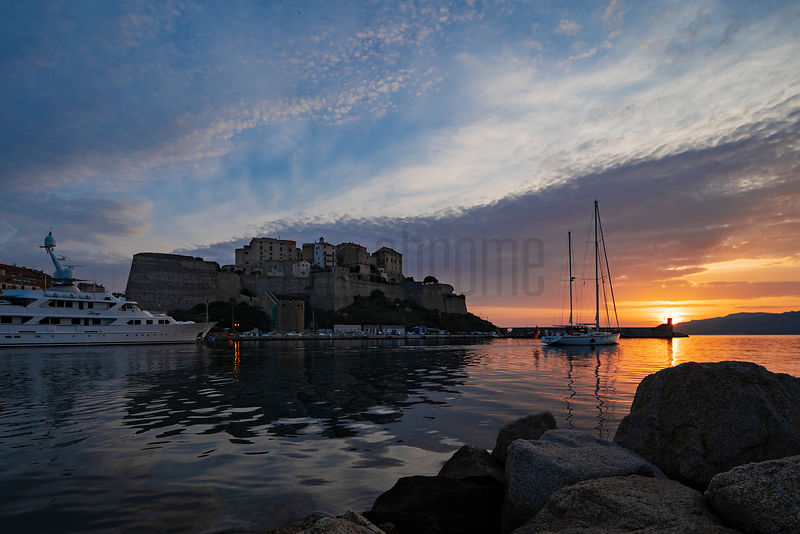 Yacht Leaving Calvi Harbour at Sunrise