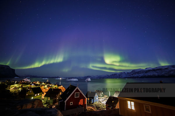 Aurora above the Uummannaq fjord as seen from the terrace of the guesthouse in town