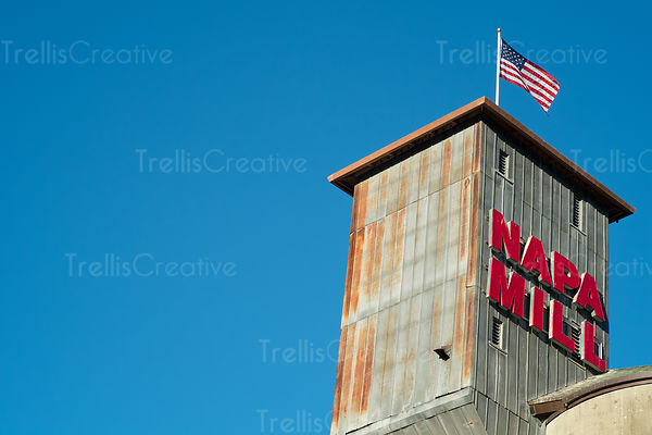 The Napa Mill sign on the historic building against the clear blue sky
