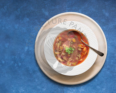 Bowl of Minestrone soup with a spoon.