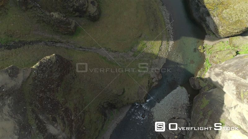 Aerial Flyover of Fjadragljufur River Canyon Iceland, Steep Cliffs Looking Straight Down