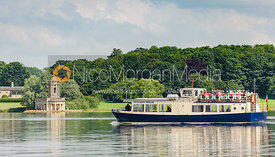 The Rutland Belle cruises past Normanton Church