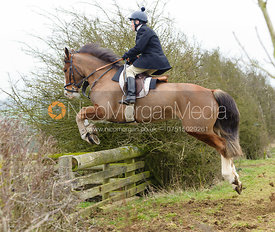 Jimmy Quinn jumps a hedge away from the meet at Ladywood Lodge