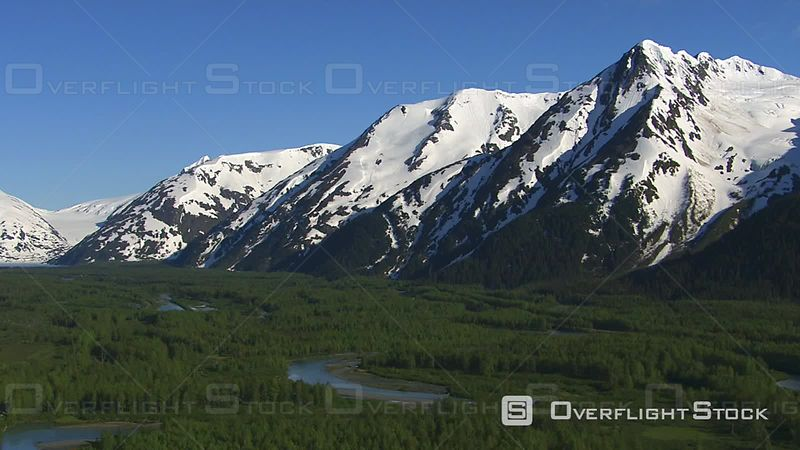 Aerial Footage of Forest Streams and Snowy Mountains, Alaska