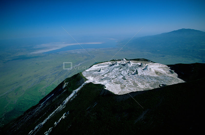 Aerial view of Ol Doinyo Lengai Crater (The Mountain of God) Rift Valley, Tanzania. Note- small cones on crater floor formed by previous eruptions of lava, still active.