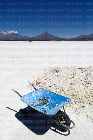 Wheelbarrow for moving salt on the Salar de Coipasa, Tata Sabaya volcano in background, Oruro Department, Bolivia
