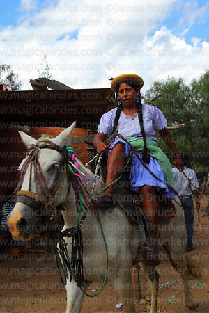 Female gaucho riding horse during carnival parades, Canasmoro, Tarija Department, Bolivia