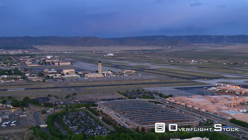 Flight past industrial area to Albuquerque International Airport.